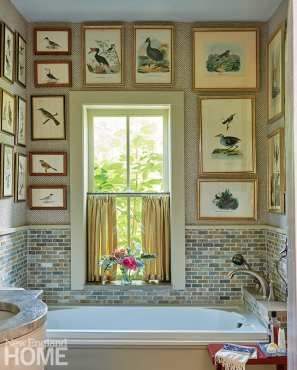 Bathroom with vintage bird prints on the walls