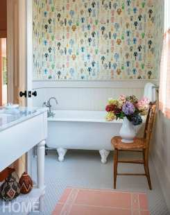 A guest bathroom's Lee Jofa wallpaper was a favorite of the designer's two daughters when they were children.