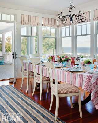 """The designer sets her table with an eclectic mix of accessories from all over the globe, like this tablecloth from South Africa, her own line of ceramics, bowls filled with seashells, and a mix of glassware. """"You should see the suitcases I bring back when I travel,"""" she says with a laugh."""