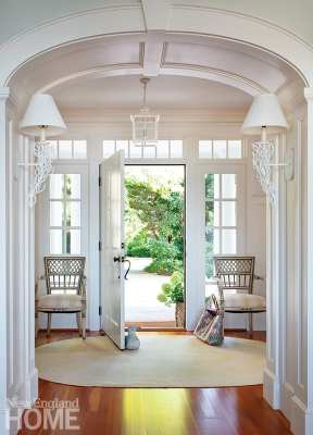 The chairs flanking the front door came from the now-defunct Antiques on Cambridge Street; Lee Jofa sconces grace the walls.