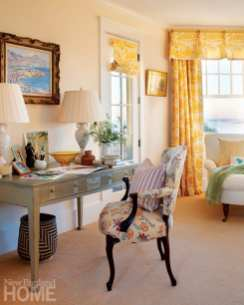"""When Skok has a house full of summer guests, she'll take a break to """"rest her eyes"""" on the master bedroom's daybed. Her favorite yellow toile curtains frame the window."""