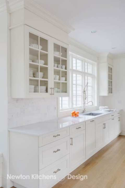 These cabinets have melamine boxes instead of solid wood. This is a construction element that you can't see so it doesn't effect the aesthetics of the kitchen.