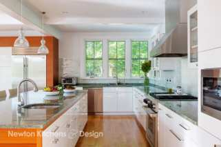 The layout of this kitchen minimized the use of upper cabinets bringing the cost down while giving the kitchen a light and airy look.
