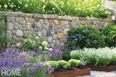 For a wall that supports a ledge, the designer chose rough natural fieldstone for its visual interest.