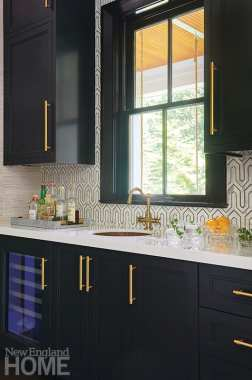 Bar area with dark cabinetry.