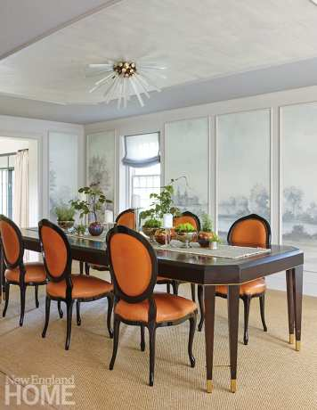 formal dining room with orange leather chairs.