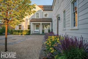 Exterior of home with gravel parking court