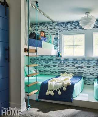 """""""I love bunkrooms,"""" admits Crestin. """"I go a little bit nuts about them."""" For this one, she placed two queen mattresses toe to toe on the bottom bunk and two extra-long twins, accessible via a rope ladder, above."""