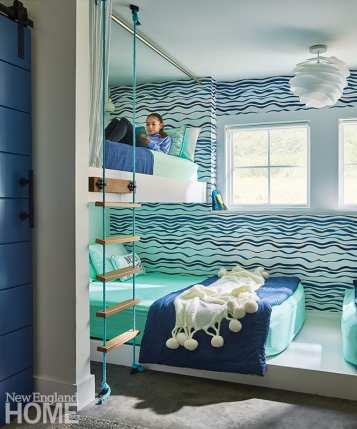 """I love bunkrooms,"" admits Crestin. ""I go a little bit nuts about them."" For this one, she placed two queen mattresses toe to toe on the bottom bunk and two extra-long twins, accessible via a rope ladder, above."