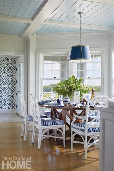 A milky-blue coffered beadboard ceiling lends warmth to a breakfast nook, while dotted chair cushions play off the hallway's lattice wallpaper for punch.
