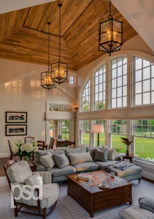 A large arch-topped window opens up a grand playroom to the backyard.