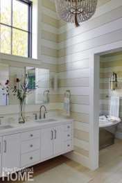 """Beckwith describes the main bath, with alternately painted horizontal boards, as """"a little day at the beach."""""""