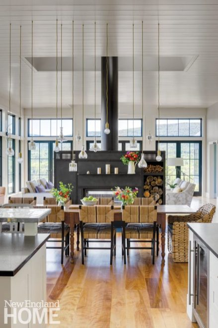 A massive steel fireplace divides the dining and lounging areas.