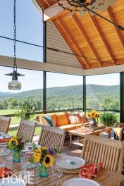 Further uphill, in its own separate screened pavilion, is an outdoor dining space protected from the elements. This open room includes both a sitting area and a table large enough to seat a dozen guests