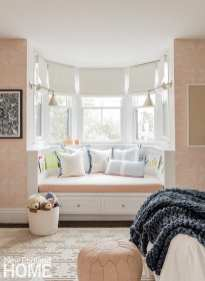 Pops of pink in the daughter's room, such as Hygge & West's blush Andanza wallpaper, are grounded by blue accents.