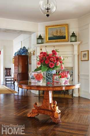 The entry hall's center table is English Regency, circa 1820.
