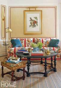 In the TV room, an original John James Audubon engraving hangs above a sofa upholstered in Brunschwig & Fils's iconic La Portugaise fabric. The Missoni carpet is by Stark.