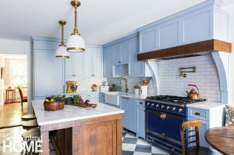 The paint color of the cabinets, Icy by Sherwin-Williams, ties in the period-appropriate wallpaper the homeowner used in the dining room. The marble checkerboard-patterned floor tiles by Paris Ceramics, which are honed and slightly tumbled, have a Victorian sensibility inspired by what one might have found in a kitchen of this era.
