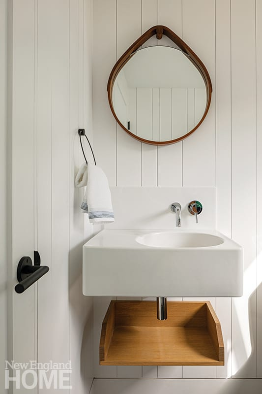Contemporary white powder room with nickel-gap paneling