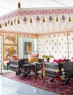 Maharaja daybeds from Morocco sit beneath a hand-painted Indian tent that can be custom made in a variety of sizes. The tents are intended for outdoor use, but many customers are using them to create cozy spaces within their homes.
