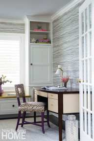 Wallpaper from Thibaut adds interest to the his-and-her office space.