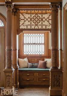 Approachable, bohemian fabrics dress down the ornate fretwork in the foyer.