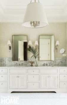 A taller backsplash in the main bathroom lends an Old World feel to the space.