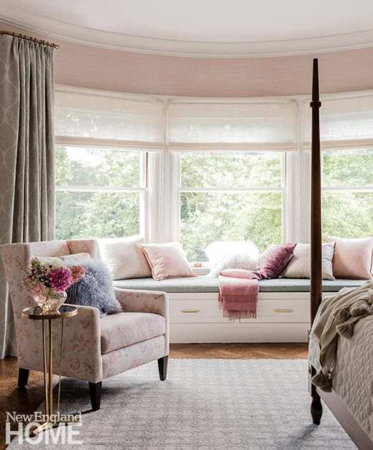 """""""Everyone looks best in blush,"""" says LeBlanc of the inspiration behind the main bedroom, which has a lush, layered, feminine feel; the replica bed is from Leonards New England, and the drapes are from Rogers & Goffigon."""