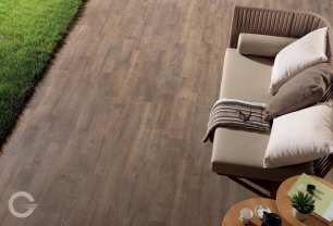 Enjoy the visual impact of a wood patio with the ease of porcelain, shown: Soul Walnut.