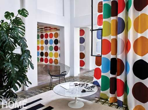 A colorful room featuring the Liz Roach Optimism collection for Pierre Frey.