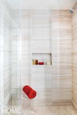 Bathroom shower with large tile.