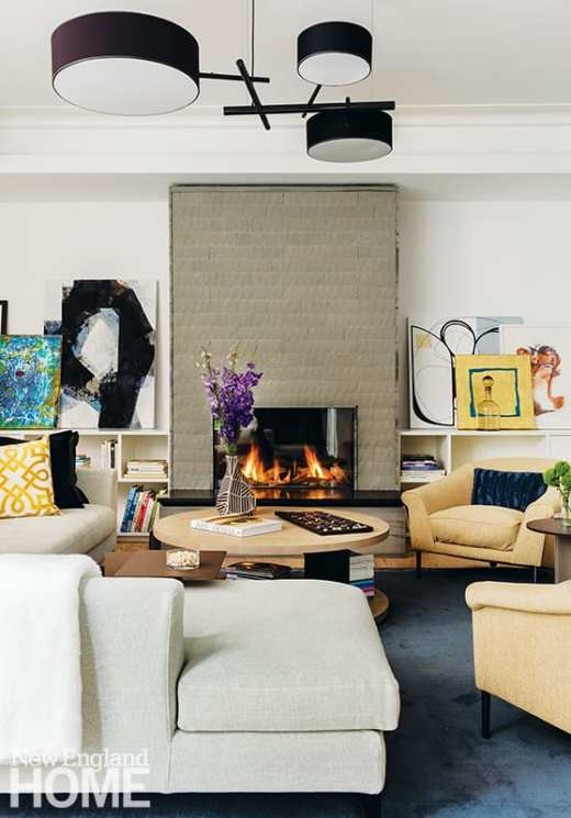 Family room with gas fireplace and contemporary art collection