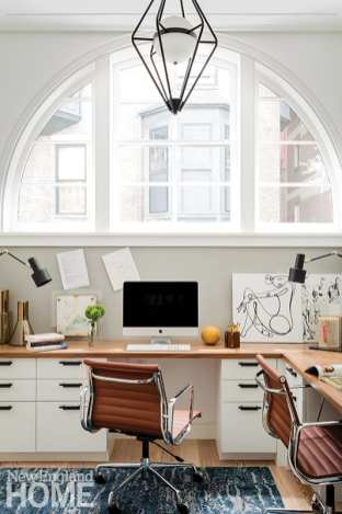 Office with white cabinetry and leather chair