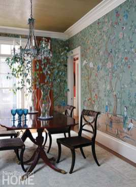The dining room walls wear de Gournay's showstopping Abbotsford mural wallpaper. A glossy strié tea paper on the ceiling is an additional touch of glamour.