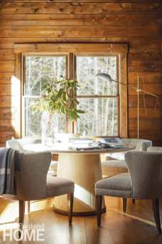Dining area with round table and rustic wood walls