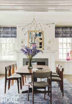 Dining room with fireplace and contemporary chandelier