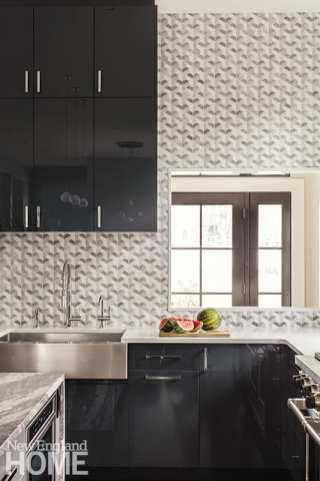 Dark cabinetry and marble mosaic backsplash