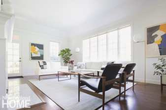 Neutral living room with white couches and leather chairs