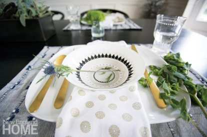 Block-print linens layered with gold flatware add glam to the table while a single thistle stem gives it a foraged feel.