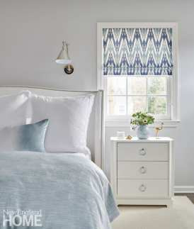 Pale gray bedroom with blue accents