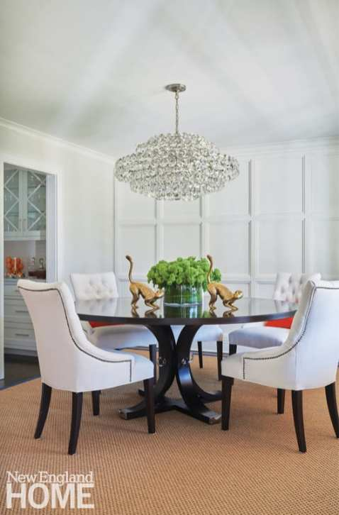 A round dining table with bubble chandelier