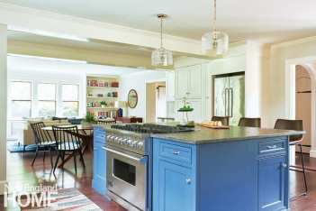 Down came two walls to create an open-plan kitchen, breakfast area, and family room.