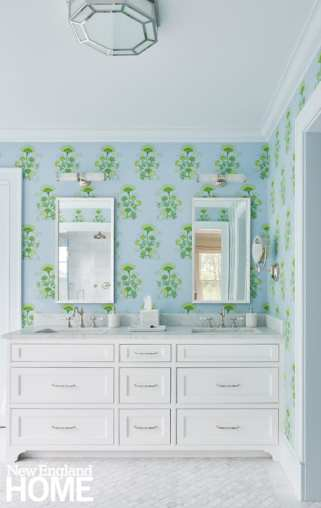 White bathroom vanity with blue and green Katie Ridder wallpaper