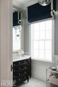 Bathroom with a Roman-style shade featuring a Greek Key trim.
