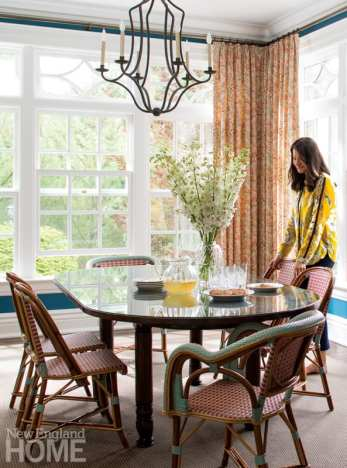 The cheery breakfast room is painted Benjamin Moore Bainbridge Blue, and the Drucker bistro chairs can be easily wiped down after meals.