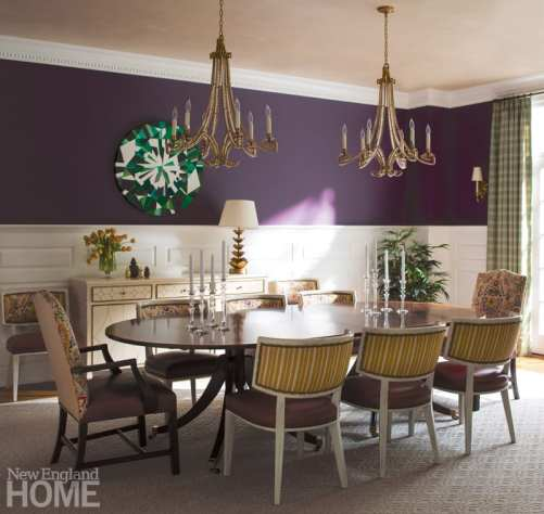 In the dining room, which is painted Benjamin Moore Ultra Violet, touches of green—in the form of patterned curtains and artwork by Cape Town-based Kurt Pio—tie into the adjacent green living room.
