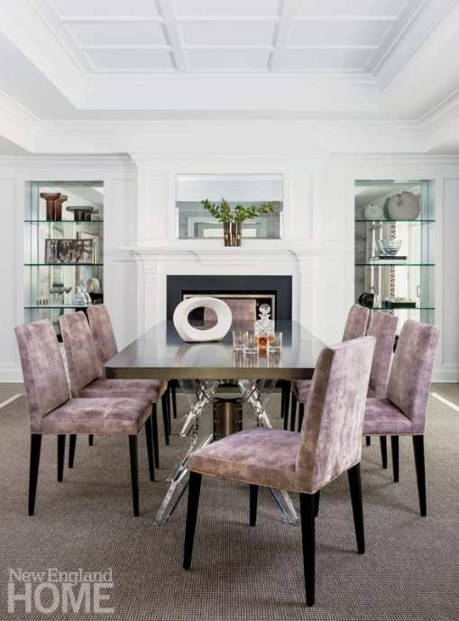 """I always like a space to have a mix of edgy and glam elements,"""" says designer Stephanie Rapp; in the dining lounge, she achieves this with the Belle Meade table—a modern acrylic base is offset by the masculine hardware that connects it."""