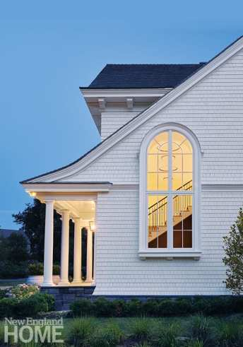 It was the homeowners' idea to add the tall, arched window that frames the stairway.