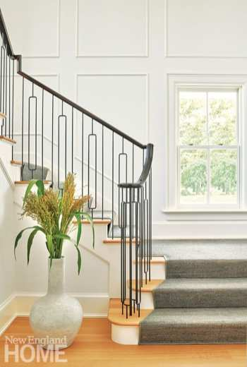 Architect Melanie Smith designed the airy, modern, metal stair railing.