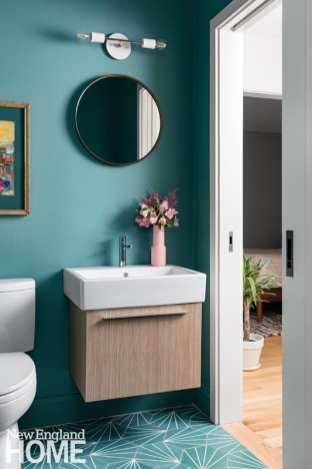 Turquoise bathroom with floating vanity